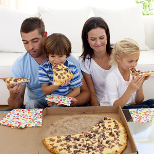 family-eating-pizza-abstaining
